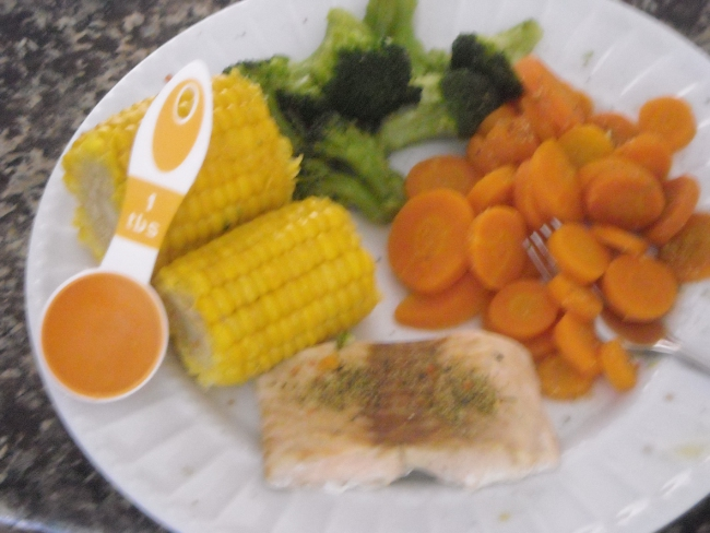 steamed salmon, steamed carrots, steamed corn on the cob,